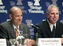 """<p>Writers and producers Howard Gordon (L) and Joel Surnow speak at a forum hosted by the Heritage Foundation, on the similarities between the war on terrorism and the television show """"24,"""" in Washington June 23, 2006. REUTERS/Micah Walter</p>"""
