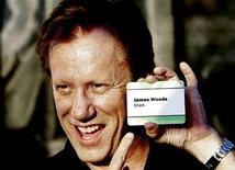 """<p>James Woods points at his name tag at the CBS summer press tour party at the Rose Bowl in Pasadena, California, July 15, 2006. Woods stars in the CBS television series """"Shark"""". REUTERS/Mario Anzuoni</p>"""