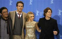 <p>Director Dennis Lee, actors Ryan Reynolds, Hayden Panettiere and Willem Dafoe (LtoR) pose during a photocall to present their film 'Fireflies in the Garden' running in the competition at the 58th Berlinale International Film Festival in Berlin, February 10, 2008. REUTERS/Fabrizio Bensch</p>
