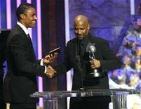 "<p>Former NBA player Rick Fox (L) presents actor Denzel Washington with the Image Award for outstanding actor in a motion picture for his role in ""The Great Debaters"", during the 39th Annual NAACP Image Awards at the Shrine auditorium in Los Angeles February 14, 2008. REUTERS/Mario Anzuoni</p>"