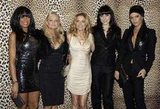 <p>Pop group Spice Girls (L-R) Mel B, Emma Bunton, Geri Halliwell, Mel C, and Victoria Beckham pose for the photographers before the Roberto Cavalli's Fall/Winter 2008/09 men's collections during Milan Fashion Week January 14, 2008 REUTERS/Alessandro Garofalo</p>