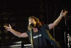 """<p>Eddie Vedder, lead singer of Pearl Jam, opens with his band for U2 at Aloha Stadium in Honolulu, Hawaii, December 9, 2006. Vedder will launch his first solo tour in Vancouver on April 2 to help promote his soundtrack album for """"Into the Wild,"""" according to a statement issued on Friday. REUTERS/Lucy Pemoni</p>"""