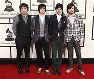 <p>Members of the group Panic at the Disco arrive at the 50th Grammy Awards in Los Angeles February 10, 2008. REUTERS/Danny Moloshok</p>
