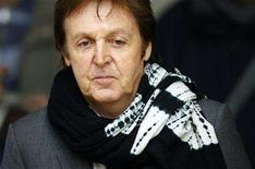 <p>Sir Paul McCartney leaves the High Court in London February 15, 2008. REUTERS/Dylan Martinez</p>