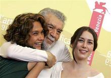 """<p>Director Alain Robbe-Grillet (C), cast members Dany Verissimo (L) and Marie Espinosa pose during a photocall to introduce their film 'C'est Gradiva qui vous appelle' at the Venice Film Festival, September 8, 2006. Robbe-Grillet, an """"enfant terrible"""" of France's literary establishment who helped found the New Novel school in the 1950s, died on Monday aged 85, his publishers said. REUTERS/Fabrizio Bensch</p>"""