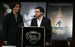 """<p>Writers Ethan (R) and Joel Coen accept the Best Adapted Screenplay award for their work with """"No Country For Old Men"""" during the National Board Of Review of Motion Pictures award gala in New York January 15, 2008. REUTERS/Lucas Jackson</p>"""