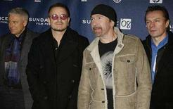 """<p>Members of the band U2 (L-R) Adam Clayton, Bono, The Edge and Larry Mullen pose for photographers as they arrive for the premiere of """"U2 3D"""" the first digital 3D concert film by directors Catherine Owens and Mark Pellington at the 2008 Sundance Film Festival in Park City, Utah in this file photo from January 19, 2008. REUTERS/Fred Prouser</p>"""