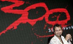 "<p>Hollywood actor Gerard Butler smiles during a news conference for his new movie ""300"" in Tokyo June 7, 2007. REUTERS/Toru Hanai</p>"