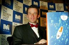 <p>Author Yann Martel poses for photographs after winning the Booker Prize for Fiction 2002 at The British Museum in London October 22, 2002. REUTERS/Peter Macdiarmid.</p>