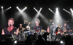 <p>Bassist and lead singer Sting (L), drummer Stewart Copeland (C) and guitarist Andy Summers perform during The Police Live in Concert in Tokyo, February 13, 2007. REUTERS/Issei Kato</p>