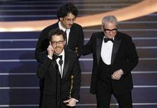 "<p>Ethan (L) and Joel Coen (C) accept the Oscar for best directing for ""No Country For Old Men"" from director Martin Scorsese during the 80th annual Academy Awards, the Oscars, in Hollywood February 24, 2008. REUTERS/Gary Hershorn</p>"