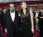 "<p>Best director Oscar nominee Julian Schnabel from the film ""The Diving Bell and the Butterfly,"" arrives with his wife, Olatz Lopez Garmendia, at the 80th annual Academy Awards, the Oscars, in Hollywood February 24, 2008. REUTERS/Mario Anzuoni</p>"
