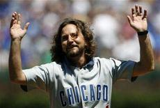 "<p>Pearl Jam's lead singer Eddie Vedder celebrates throwing out the first pitch before the New York Mets and Chicago Cubs National League MLB baseball game in Chicago, August 3, 2007. New Zealand singer/songwriter Liam Finn will open the seven shows on Vedder's ""April Fool's Tour"" of the West Coast, which kicks off April 2 in Vancouver, B.C. Finn is currently on the road to promote his solo debut, ""I'll Be Lightning"" (Yep Roc). REUTERS/John Gress</p>"
