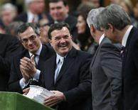 <p>Finance Minister Jim Flaherty smiles as he prepares to deliver the budget in the House of Commons on Parliament Hill, February 26, 2008. REUTERS/Chris Wattie</p>