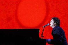 <p>British singer Paul McCartney performs at the Brit Awards at Earls Court in London February 20, 2008. McCartney is due to learn on March 17 how many of his millions he must hand over to Heather Mills as part of their divorce settlement. REUTERS/Alessia Pierdomenico</p>