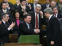 <p>Canada's Finance Minister Jim Flaherty (C) shakes hands with Prime Minister Stephen Harper after delivering his budget to the House of Commons on Parliament Hill in Ottawa February 26, 2008. REUTERS/Chris Wattie</p>