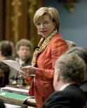 <p>Quebec's Finance Minister Monique Jerome-Forget (C) looks at Quebec's Premier Jean Charest (R) as she speaks during the questions period at the National Assembly in Quebec City June 1, 2007. REUTERS/Jacques Boissinot/Pool</p>