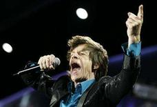 """<p>Rolling Stones singer Mick Jagger performs during a concert on the band's """"A Bigger Bang"""" European Tour in Warsaw July 25, 2007. REUTERS/Kacper Pempel</p>"""
