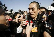 <p>Chinese film director Zhang Yimou is surrounded by journalists on his way to attend the opening of the Chinese People's Political Consultative Conference at the Great Hall of the People in Beijing March 3, 2008. REUTERS/Claro Cortes IV</p>