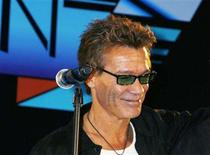 <p>Guitarist Eddie Van Halen during a news conference in Beverly Hills, August 13, 2007. Van Halen is undergoing tests for an undisclosed medical problem, causing his band to reschedule four upcoming U.S. concerts, a spokesman for the tour promoter said on Monday. REUTERS/Fred Prouser</p>