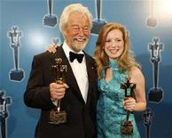"""<p>Actor Gordon Pinsent (L) and director Sarah Polley hold their awards for their work in """"Away From Her"""" at the 28th annual Genie Awards in Toronto March 3, 2008. REUTERS/Mark Blinch</p>"""