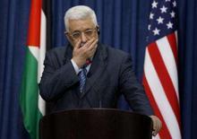 <p>Abbas condiciona retomada de negociação de paz com cessar-fogo. O presidente palestino, Mahmoud Abbas, disse nesta quarta-feira que só voltará a negociar um acordo de paz com Israel se houver um cessar-fogo entre as tropas israelenses e militantes palestinos. 4 de março. Photo by Eliana Aponte</p>