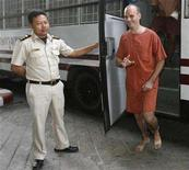 """<p>Canadian Christopher Paul Neil arrives at the Bangkok Criminal Court March 10, 2008. Neil went on trial in Thailand on Monday, more than four months after he was arrested in a global man-hunt triggered by """"swirly face"""" images of abuse found on the Internet. REUTERS/Chaiwat Subprasom</p>"""