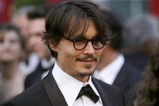 """<p>Johnny Depp, Oscar nominee for best actor in """"Sweeny Todd:The Demon Barber of Fleet Street,"""" arrives at the 80th annual Academy Awards in Hollywood February 24, 2008. REUTERS/Lucas Jackson</p>"""