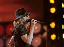 <p>Madonna performs at Wembley Stadium, July 7, 2007. Madonna, folk singer Leonard Cohen, rocker John Mellencamp, British pop band The Dave Clark Five and instrumental group The Ventures will be inducted into the Rock and Roll Hall of Fame on Monday. REUTERS/Stephen Hird</p>