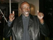 "<p>Louis Gossett,Jr. poses as he arrives as a guest at the premiere of the new drama film ""Ray"" in Hollywood October 19, 2004. REUTERS/Fred Prouser</p>"