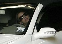 <p>Britney Spears drives her car out of the garage of Los Angeles Superior Court after a child custody hearing with her ex-husband regarding her two sons in Los Angeles, California October 26, 2007. REUTERS/Fred Prouser</p>