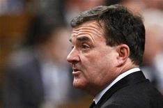 <p>Finance Minister Jim Flaherty stands to speak during Question Period in the House of Commons on Parliament Hill in Ottawa February 27, 2008. REUTERS/Chris Wattie</p>