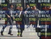 <p>As bolsas de valores asiáticas se recuperaram na quarta-feira, animadas pelo anúncio de uma ação conjunta do Federal Reserve e outros bancos centrais do mundo para injetar centenas de bilhões de dólares no mercado. Photo by Toru Hanai</p>