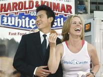 """<p>In this file photo actor John Cho, star of the new comedy film """"Harold and Kumar Go to White Castle"""" poses with friend, actress Cheryl Hines at the film's premiere. Actor John Cho, star of the new comedy film """"Harold and Kumar Go to White Castle"""" poses with friend, actress Cheryl Hines at the film's premiere in Hollywood July 27, 2004. When Warner Bros. takes over New Line Cinema it will first handle the comedy sequel """"Harold & Kumar Escape From Guantanamo Bay,"""" which is set for an April 25 release. REUTERS/Fred Prouser</p>"""