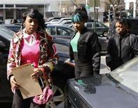 <p>Rapper Remy Ma (L) arrives at the Manhattan Criminal Court after returning from lunch in New York City, March 10, 2008. REUTERS/Joshua Lott</p>