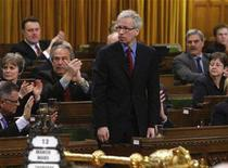 <p>Canada's Liberal leader Stephane Dion (C) stands to vote to extend Canada's military mission in Afghanistan until 2011 in the House of Commons on Parliament Hill in Ottawa March 13, 2008. REUTERS/Chris Wattie</p>