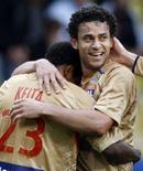 <p>Fred (direita) comemora depois de marcar o segundo gol do Lyon contra o Monaco. Photo by Eric Gaillard</p>