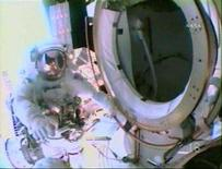 <p>Spacewalker Mike Foreman is seen outside the International Space Station's Qwest airlock in this view from the helmet camera of fellow spacewalker Rick Linnehan at the beginning of their extravehicular excursion (EVA) in this image from NASA TV March 15, 2008. Linnehan and Foreman will complete the assembly of the Canadian Space Agency's two-armed robotic system Dextre during their EVA. REUTERS/NASA TV.</p>