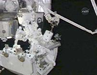 <p>Spacewalker Robert Behnken(L) works on the Canadian Space Agency's two-armed robotic system Dextre as spacewalker Rick Linnehan works in the background during a spacewalk in this image from NASA TV March 17, 2008. REUTERS/NASA TV</p>