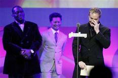 <p>Brian Graden, president of programming at MTV, VH1, CMT, and Logo, accepts an award during the 19th annual GLAAD Media awards in New York March 17, 2008. REUTERS/Lucas Jackson</p>