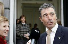 <p>Denmark's Prime Minister Anders Fogh Rasmussen conducts a doorstep interview as he arrives for a meeting of the Prime Ministers of the European Liberal Democrat and Reform Party (ELDR) ahead of the European summit in Brussels March 13, 2008. REUTERS/Sebastien Pirlet</p>