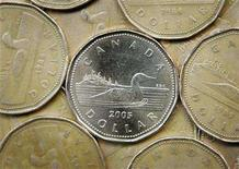 <p>A Canadian one dollar coin, also know as a loonie, is shown in Montreal, April 28, 2006. REUTERS/Shaun Best</p>