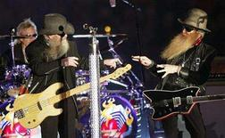 <p>Members of the band ZZ Top (L-R) Frank Beard, Dusty Hill, and Billy Gibbons perform at halftime during the NCAA Orange Bowl football game between the Kansas Jayhawks and Virginia Tech Hokies in Miami, Florida, January 3, 2008. REUTERS/Hans Deryk</p>