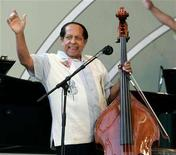 "<p>Cuban-born musician Israel ""Cachao"" Lopez, known for inventing the Mambo in 1938, waves to the audience after performing at the 2005 Playboy Jazz Festival at the Hollywood Bowl in Hollywood June 11, 2005. Lopez died on Saturday March 22, media reports said. REUTERS/Fred Prouser</p>"