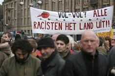 <p>Demonstrators hold banners during a protest against Dutch politician and anti-Islam filmmaker Geert Wilders on Dam square in Amsterdam, March 22, 2008. REUTERS/Ade Johnson (</p>