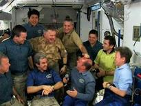 <p>Rick Linnehan pats Garrett Reisman on the head during the farewell ceremony from aboard the International Space Station with the crews of the shuttle Endeavour and the ISS (L-R) Dominic Gorie, Mike Foreman, Takao Doi, Gregory Johnson, Leopold Eyeharts, Robert Behnken, Yuri Malenchenko and Peggy Whitson in this image from NASA TV March 24, 2008. REUTERS/NASA TV.</p>