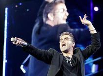 <p>British pop singer George Michael performs at the OAKA Stadium in Athens, July 26, 2007. REUTERS/John Kolesidis</p>