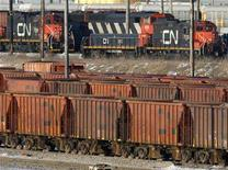 <p>Rail cars sit in the CN MacMillan Yard in Toronto February 10, 2007. REUTERS/J.P. Moczulski</p>