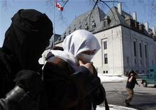 <p>Maha Elsamnah (C), mother of Omar Khadr, who is being detained by U.S. forces at Guantanamo Bay, leaves the Supreme Court of Canada in Ottawa March 26, 2008. The Supreme Court is hearing arguments from lawyers for Omar Khadr, who is charged with murdering a U.S. soldier in Afghanistan in a firefight when he was 15. Omar, now 21, was taken prisoner in 2002. He said in an affidavit that U.S. interrogators repeatedly threatened to rape him and Canadian government officials told him they were powerless to do anything. REUTERS/Chris Wattie</p>