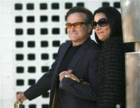 """<p>Robin Williams and his wife Marsha at the premiere of """"License to Wed"""" in Hollywood, June 25, 2007. Williams' second wife, whom he met when she was his nanny, has filed for divorce citing irreconcilable differences. REUTERS/Mario Anzuoni</p>"""